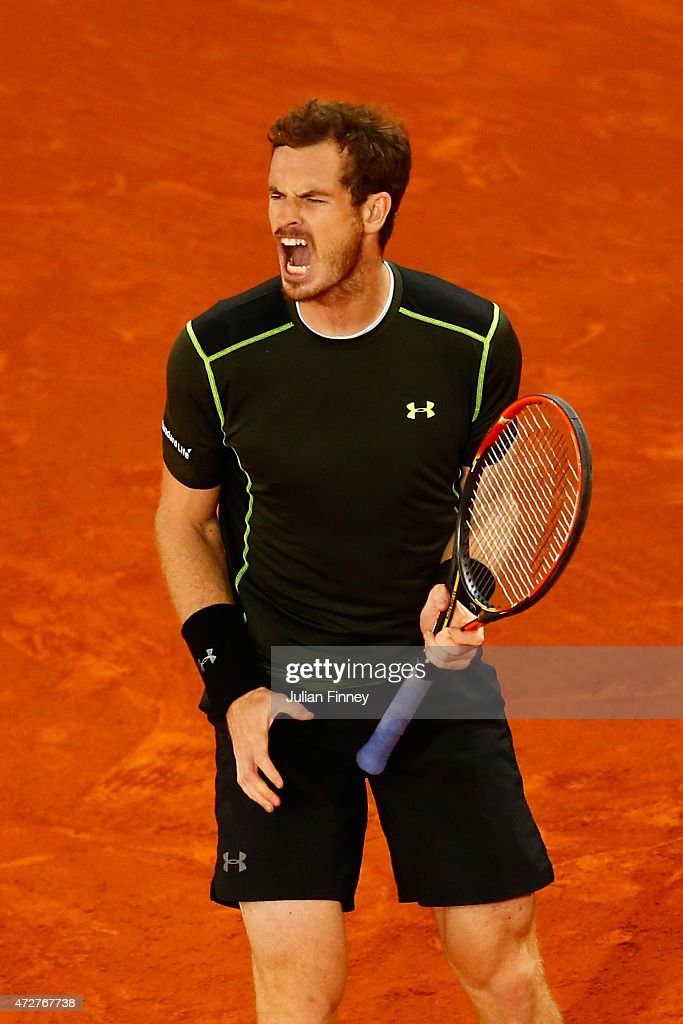 Andy Murray of Great Britain celebrates winning a game against Kei Nishikori of Japan in the semi final during day eight of the Mutua Madrid Open tennis tournament at the Caja Magica on May 9, 2015 in Madrid, Spain.