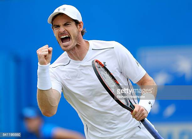 Andy Murray of Great Britain celebrates winning a game during the final of The Aegon Championships aganist Milos Raonic of Canada on day seven at The...