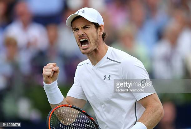 Andy Murray of Great Britain celebrates winning a game during the final of The Aegon Championships aganist Milos Raonic of Canada on day seven at...