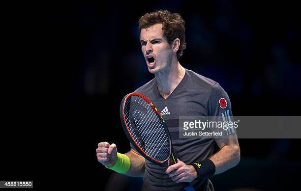 Andy Murray of Great Britain celebrates winning a point during his round robin singles match against Milos Raonic of Canada on day three of the...