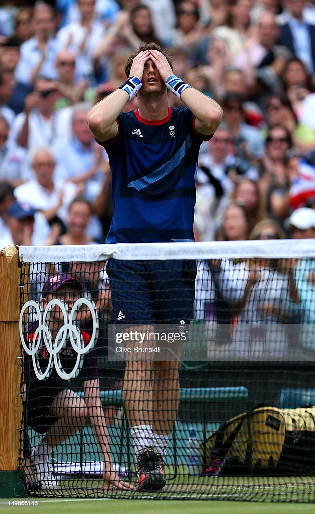 <a gi-track='captionPersonalityLinkClicked' href=/galleries/search?phrase=Andy+Murray+-+Tennis+Player&family=editorial&specificpeople=200668 ng-click='$event.stopPropagation()'>Andy Murray</a> of Great Britain celebrates winning gold after defeating Roger Federer of Switzerland in the Men's Singles Tennis Gold Medal Match on Day 9 of the London 2012 Olympic Games at the All England Lawn Tennis and Croquet Club on August 5, 2012 in London, England. Murray defeated Federer in the gold medal match in straight sets 2-6, 1-6, 4-6.
