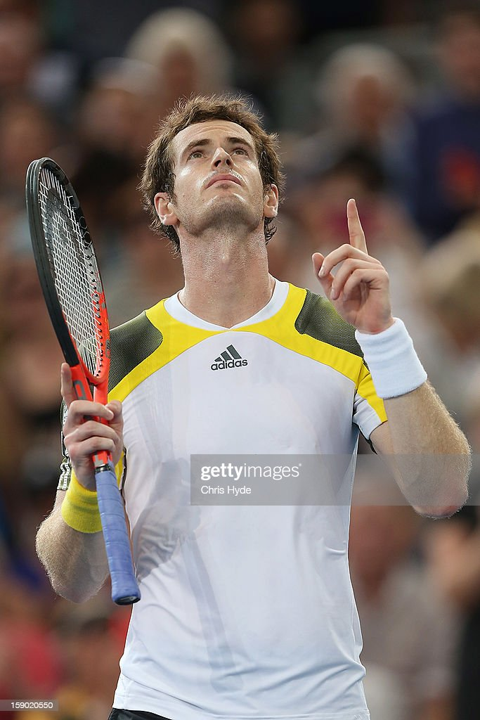 Andy Murray of Great Britain celebrates winning his final match against Grigor Dimitrov of Bulgaria on day eight of the Brisbane International at Pat Rafter Arena on January 6, 2013 in Brisbane, Australia.