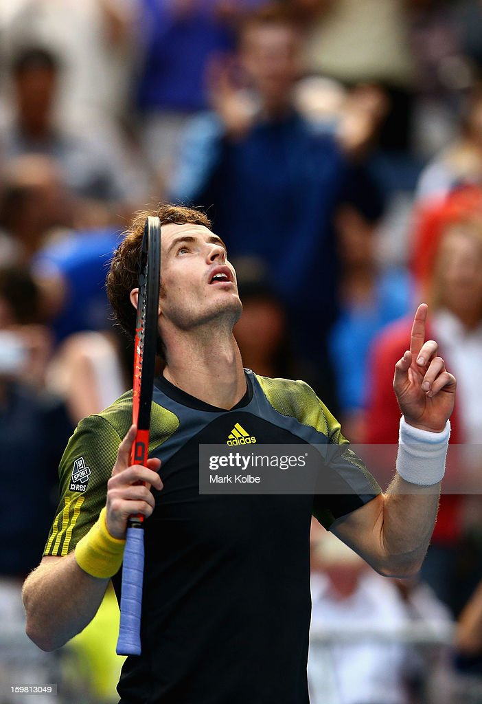 Andy Murray of Great Britain celebrates winning his fourth round match against Gilles Simon of France during day eight of the 2013 Australian Open at Melbourne Park on January 21, 2013 in Melbourne, Australia.