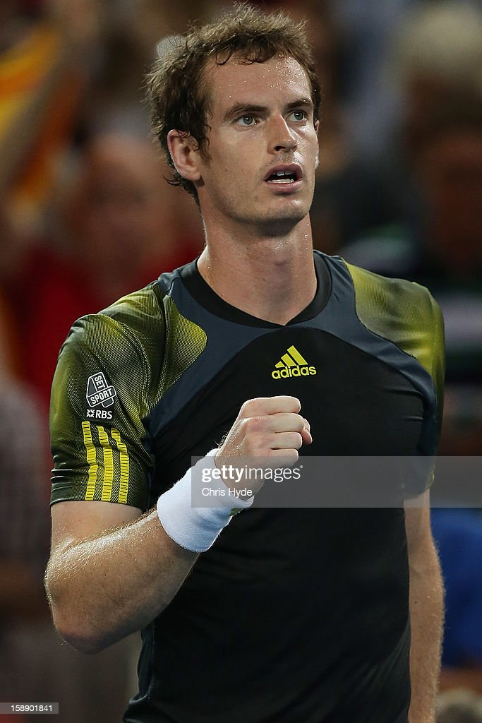 <a gi-track='captionPersonalityLinkClicked' href=/galleries/search?phrase=Andy+Murray+-+Tennisser&family=editorial&specificpeople=200668 ng-click='$event.stopPropagation()'>Andy Murray</a> of Great Britain celebrates winning his match against John Millman of Australia on during day five of the Brisbane International at Pat Rafter Arena on January 3, 2013 in Brisbane, Australia.
