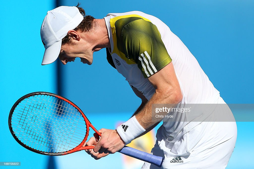 Andy Murray of Great Britain celebrates winning his third round match against Ricardas Berankis of Lithuania during day six of the 2013 Australian Open at Melbourne Park on January 19, 2013 in Melbourne, Australia.