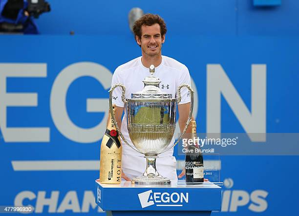 Andy Murray of Great Britain celebrates winning the Aegon Championships with Moet Imperial and the winners trophy after defeating Kevin Anderson of...