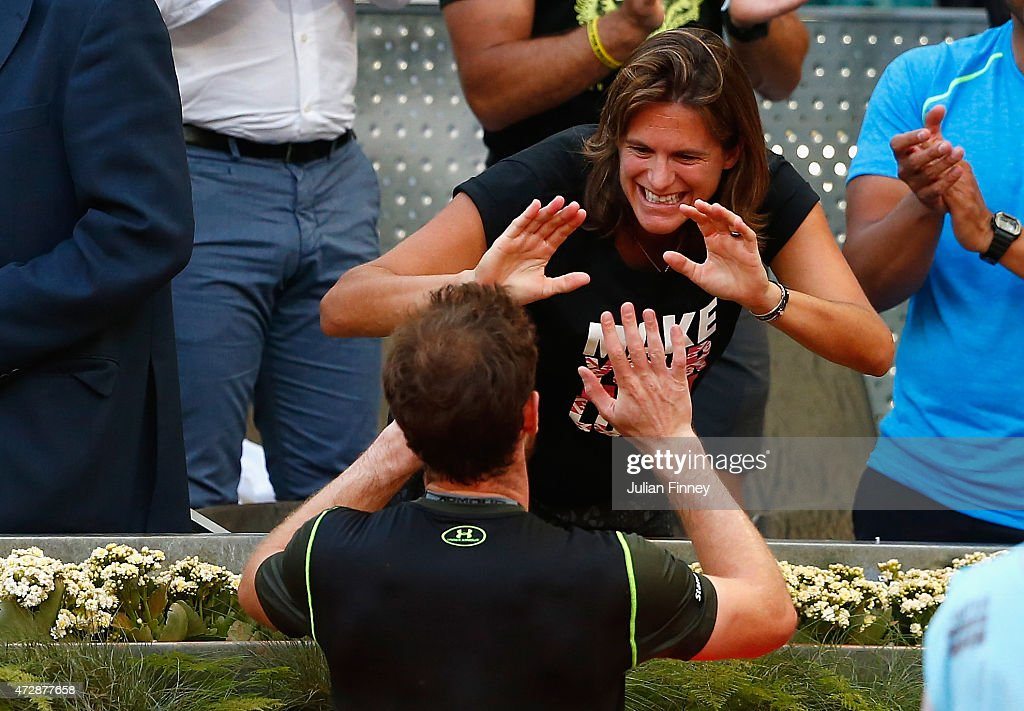 <a gi-track='captionPersonalityLinkClicked' href=/galleries/search?phrase=Andy+Murray+-+Tennis+Player&family=editorial&specificpeople=200668 ng-click='$event.stopPropagation()'>Andy Murray</a> of Great Britain celebrates with coach <a gi-track='captionPersonalityLinkClicked' href=/galleries/search?phrase=Amelie+Mauresmo&family=editorial&specificpeople=161389 ng-click='$event.stopPropagation()'>Amelie Mauresmo</a> after defeating Rafael Nadal of Spain in the final during day nine of the Mutua Madrid Open tennis tournament at the Caja Magica on May 10, 2015 in Madrid, Spain.