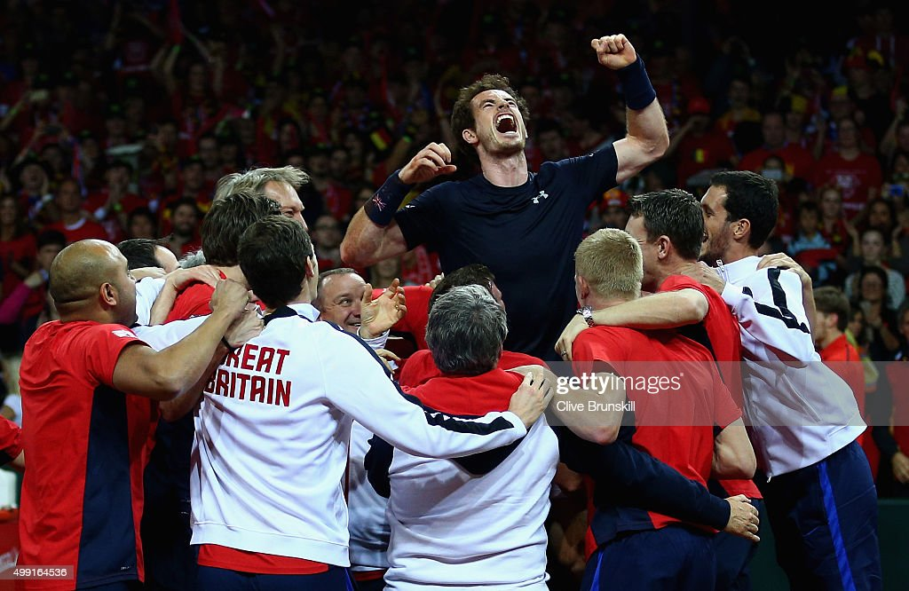 Andy Murray of Great Britain celebrates with his team after winning his singles match against David Goffin of Belgium and clinching the Davis Cup on day three of the Davis Cup Final 2015 between Belgium and Great Britain at Flanders Expo on November 29, 2015 in Ghent, Belgium.