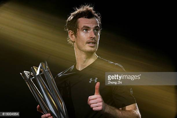 Andy Murray of Great Britain celebrates with his trophy during the award ceremony after winning the Men's singles final match against Roberto...