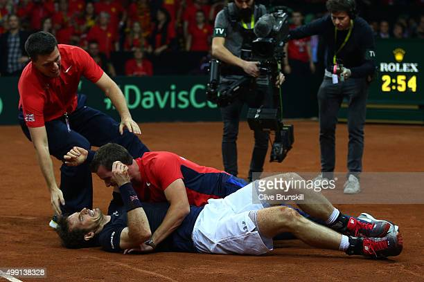 Andy Murray of Great Britain celebrates with Leon Smith the Captain of Great Britain after winning his singles match against David Goffin of Belgium...