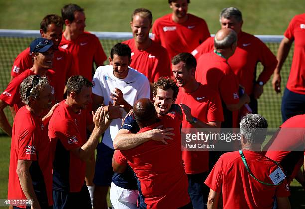 Andy Murray of Great Britain celebrates with team mates after defeating Gilles Simon of France on Day Three of The World Group Quarter Final Davis...