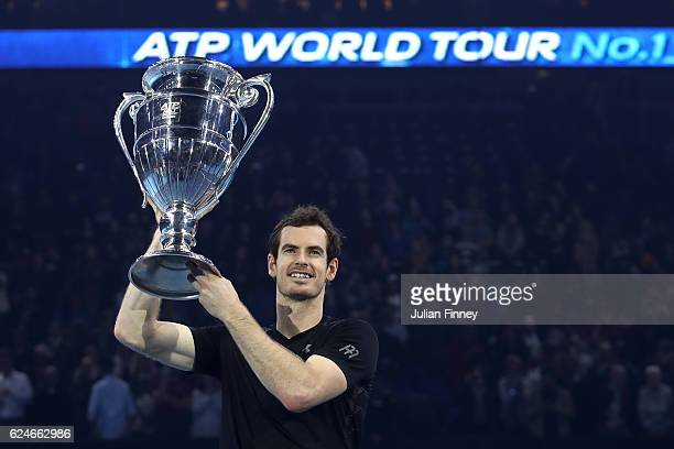 Andy Murray of Great Britain celebrates with the ATP Tour Trophy following his victory during the Singles Final against Novak Djokovic of Serbia at...