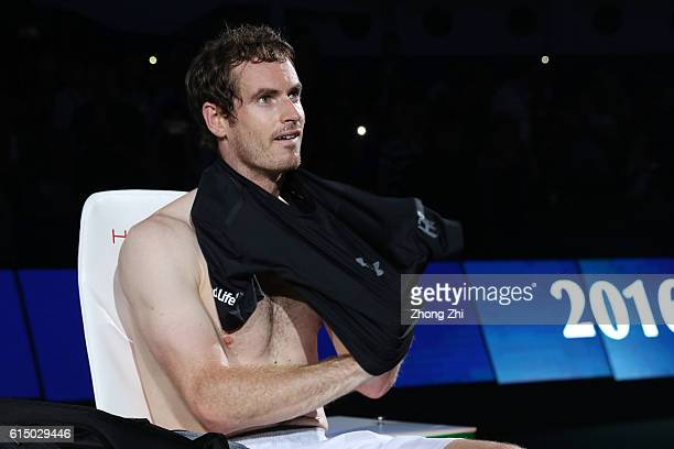 Andy Murray of Great Britain changes his shirt before the award ceremony after winning the Men's singles final match against Roberto Bautista Agut of...