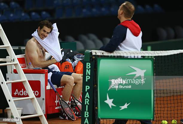 Andy Murray of Great Britain changes his shirt during a practice session ahead of the start of the Davis Cup Final at Flanders Expo on November 26...