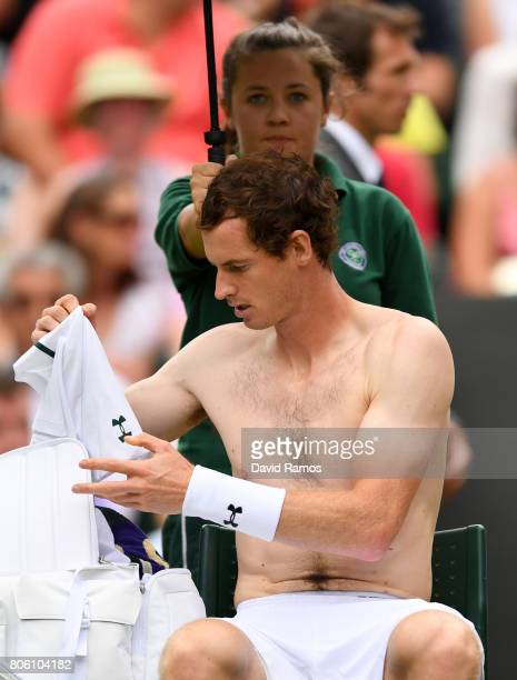 Andy Murray of Great Britain changes his shirt during the Gentlemen's Singles first round match against Alexander Bublik of Kazakhstan on day one of...