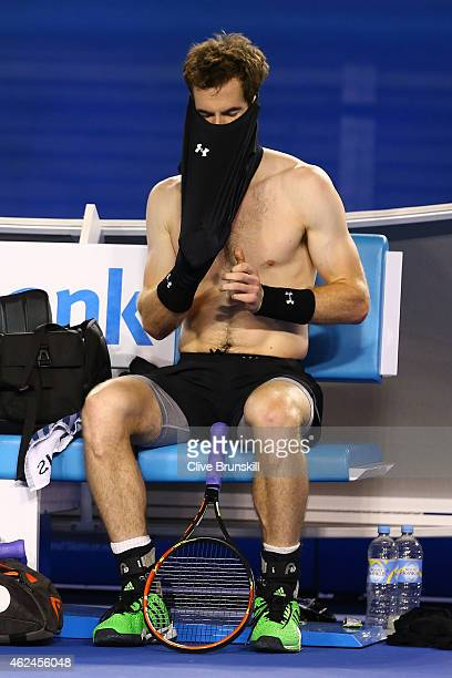 Andy Murray of Great Britain changes his shirt in his semifinal match against Tomas Berdych of the Czech Republic during day 11 of the 2015...