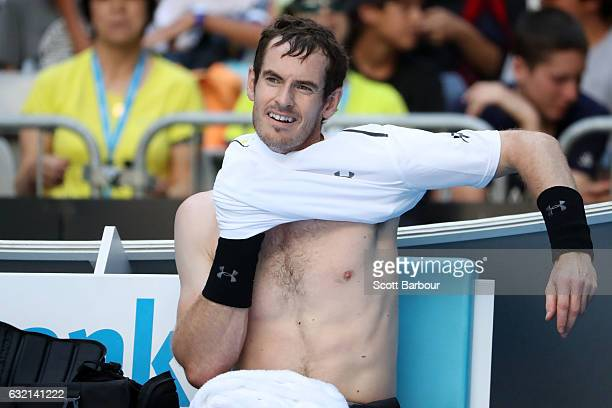 Andy Murray of Great Britain changes his shirt in his third round match against Sam Querrey of the United States on day five of the 2017 Australian...