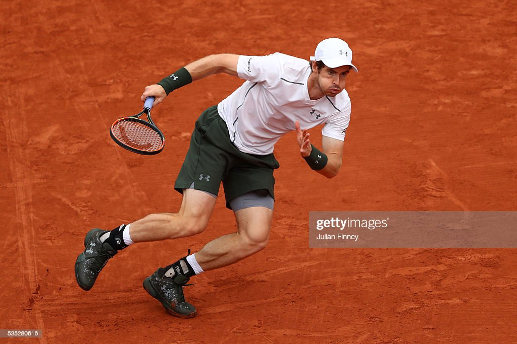 Andy Murray of Great Britain chases down the ball during the Men's Singles fourth round match against John Isner of the United States on day eight of the 2016 French Open at Roland Garros on May 29, 2016 in Paris, France.