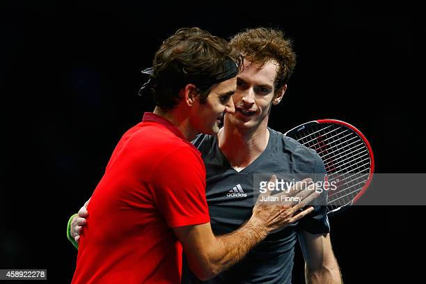 Andy Murray of Great Britain congratulates Roger Federer of Switzerland after the round robin singles match on day five of the Barclays ATP World...