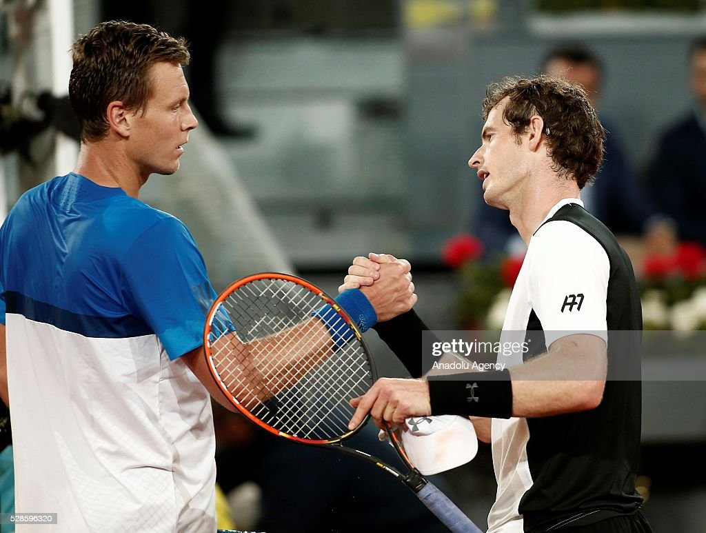 Andy Murray (R) of Great Britain congratulates Tomas Berdych of the Czech Republic as he celebrates victory after the quarter final round match during the Mutua Madrid Open tennis tournament at the Caja Magica in Madrid, Spain on May 06, 2016.