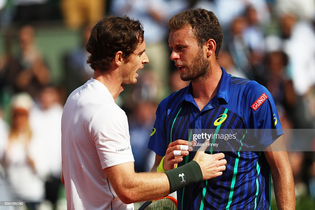 <a gi-track='captionPersonalityLinkClicked' href=/galleries/search?phrase=Andy+Murray+-+Tennisser&family=editorial&specificpeople=200668 ng-click='$event.stopPropagation()'>Andy Murray</a> of Great Britain consoles the defeated Mathias Bourgue of France at the net following the Men's Singles second round match on day four of the 2016 French Open at Roland Garros on May 25, 2016 in Paris, France.