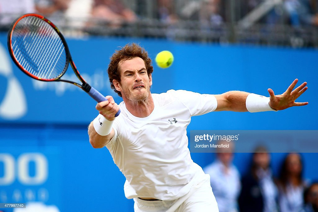 Andy Murray of Great Britain dives for a forehand in his men's singles final match against Kevin Anderson of South Africa during day seven of the Aegon Championships at Queen's Club on June 21, 2015 in London, England.