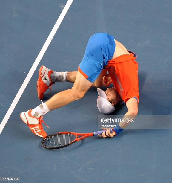 Andy Murray of Great Britain does a forward roll after a point against Michael Llodra of France during a Men's Singles 3rd round match on day six of...