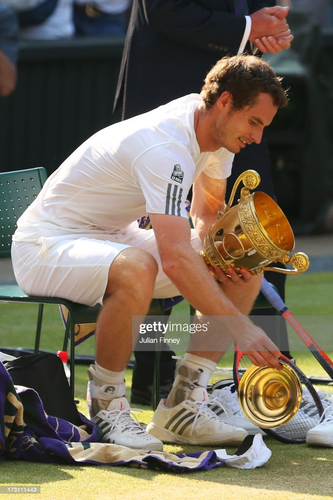 Andy Murray of Great Britain drops the lid of the Gentlemen's Singles Trophy following his victory in the Gentlemen's Singles Final match against Novak Djokovic of Serbia on day thirteen of the Wimbledon Lawn Tennis Championships at the All England Lawn Tennis and Croquet Club on July 7, 2013 in London, England.