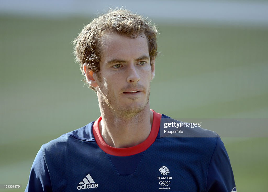 Andy Murray of Great Britain during the Mixed Doubles Tennis gold medal match against Victoria Azarenka of Belarus and Max Mirnyi of Belarus on Day 9 of the London 2012 Olympic Games at the All England Lawn Tennis and Croquet Club on August 5, 2012 in London, England.