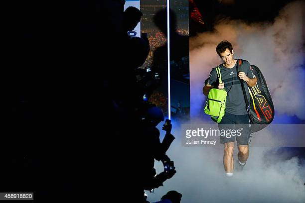 Andy Murray of Great Britain enters the court for the round robin singles match against Roger Federer of Switzerland on day five of the Barclays ATP...