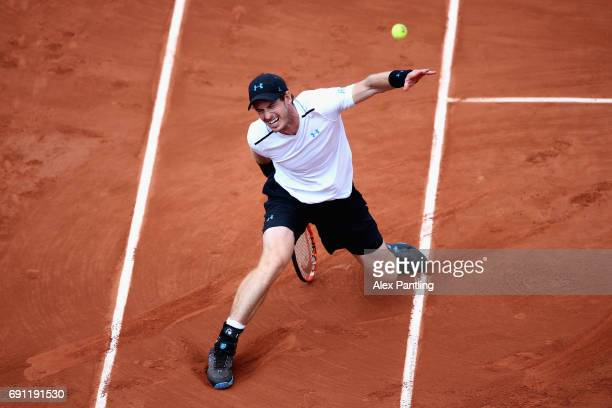 Andy Murray of Great Britain fails to reach the ball during the mens singles second round match against Martin Klizan of Slovakia on day five of the...