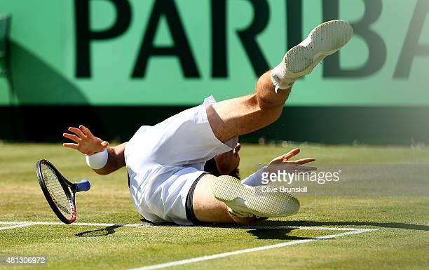 Andy Murray of Great Britain falls during his singles match against Gilles Simon of France on Day Three of The World Group Quarter Final Davis Cup...