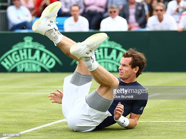 Andy Murray of Great Britain falls over in his match against JoWilfried Tsonga of France during Day One of the World Group Quarter Final Davis Cup...