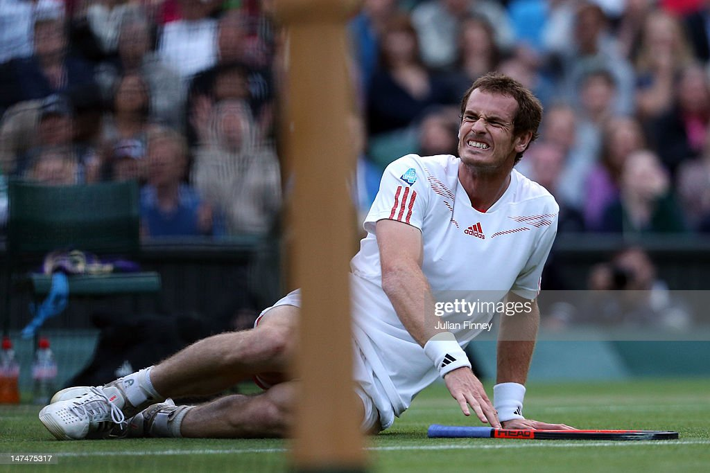<a gi-track='captionPersonalityLinkClicked' href=/galleries/search?phrase=Andy+Murray+-+Tennis+Player&family=editorial&specificpeople=200668 ng-click='$event.stopPropagation()'>Andy Murray</a> of Great Britain falls to the ground during his Gentlemen's Singles third round match against Marcos Baghdatis of Cyprus on day six of the Wimbledon Lawn Tennis Championships at the All England Lawn Tennis and Croquet Club at Wimbledon on June 30, 2012 in London, England.