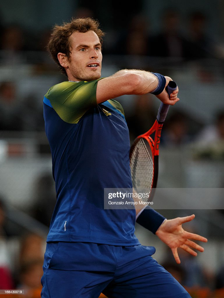 <a gi-track='captionPersonalityLinkClicked' href=/galleries/search?phrase=Andy+Murray+-+Tennis+Player&family=editorial&specificpeople=200668 ng-click='$event.stopPropagation()'>Andy Murray</a> of Great Britain follows through a ball to Gilles Simon of France during his match on day six of the Mutua Madrid Open tennis tournament at the Caja Magica on May 9, 2013 in Madrid, Spain.
