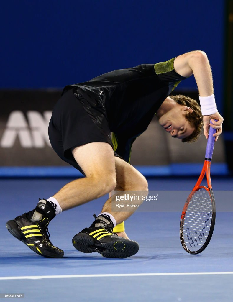 Andy Murray of Great Britain gets back on his feet after falling in his semifinal match against Roger Federer of Switzerland during day twelve of the 2013 Australian Open at Melbourne Park on January 25, 2013 in Melbourne, Australia.