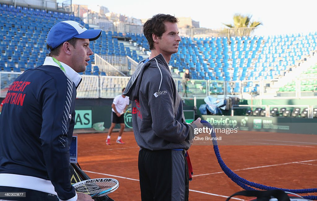 Andy Murray of Great Britain gets ready to warm up for a late practice session watched by his team captain <a gi-track='captionPersonalityLinkClicked' href=/galleries/search?phrase=Leon+Smith+-+Tennis+Coach&family=editorial&specificpeople=12698515 ng-click='$event.stopPropagation()'>Leon Smith</a> prior to the Davis Cup World Group Quarter Final match between Italy and Great Britain at Tennis Club Napoli on April 3, 2014 in Naples, Italy.