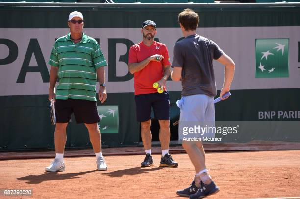 Andy Murray of Great Britain his Coach Ivan Lendl and the assistant Coach Jamie Delgado speak during a training session at the 2017 French Open at...