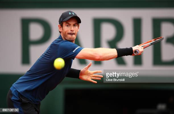Andy Murray of Great Britain hits a backhand during the first round match against Andrey Kuznetsov of Russia on day three of the 2017 French Open at...