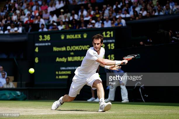 Andy Murray of Great Britain hits a backhand during the Gentlemen's Singles Final match against Novak Djokovic of Serbia on day thirteen of the...