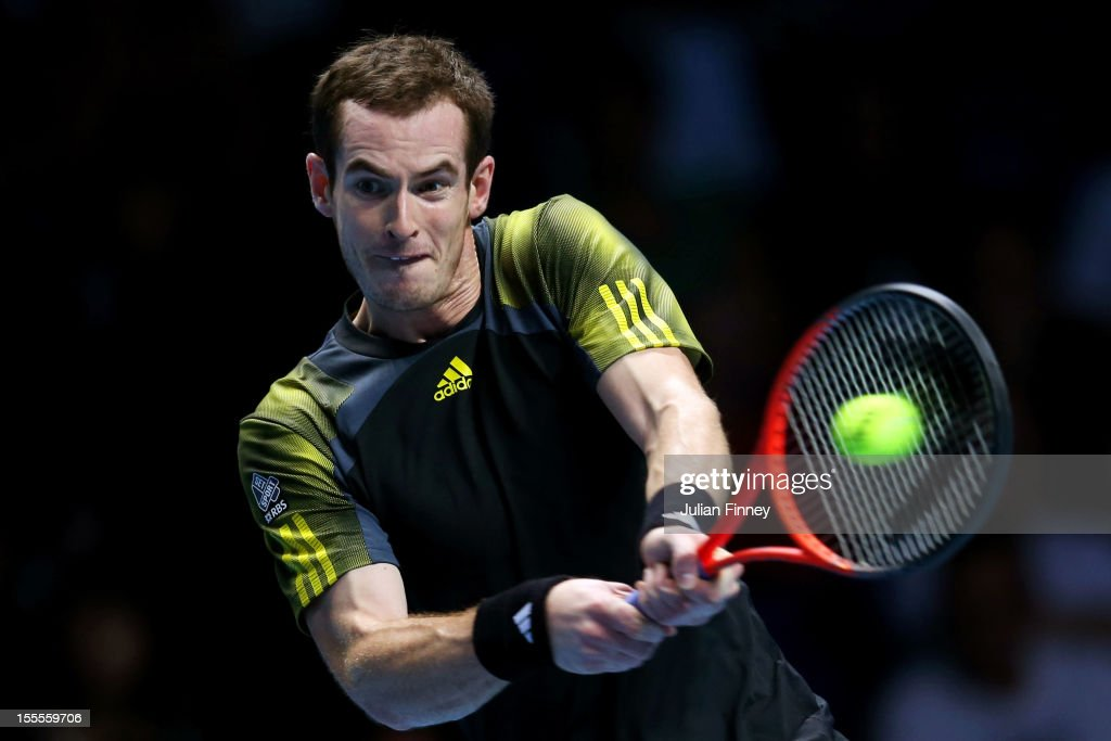 Andy Murray of Great Britain hits a backhand during the men's singles match against Tomas Berdych of Czech Republic on day one of the ATP World Tour Finals at the O2 Arena on November 5, 2012 in London, England.