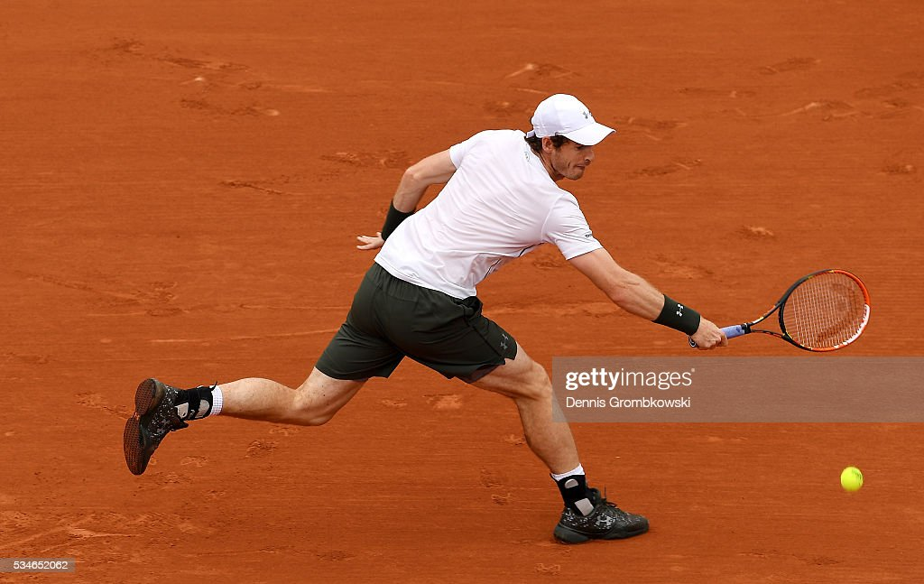 Andy Murray of Great Britain hits a backhand during the Men's Singles third round match against Ivo Karlovic of Croatia on day six of the 2016 French Open at Roland Garros on May 27, 2016 in Paris, France.
