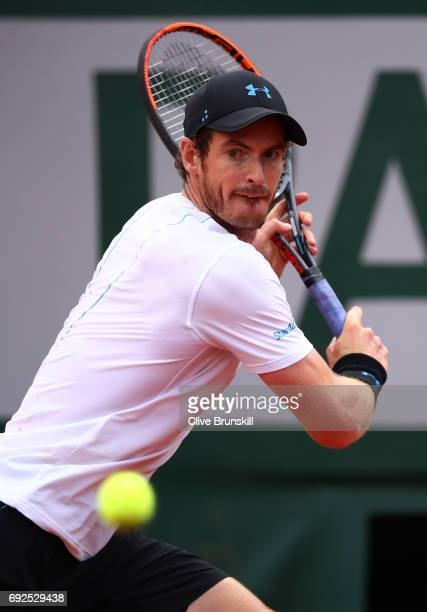 Andy Murray of Great Britain hits a backhand during the men's singles fourth round match against Karen Khachanov of Russia on day nine of the 2017...