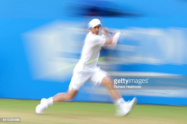 Andy Murray of Great Britain hits a backhand return during his semi final match against Maric Cilic of Croatia on day six of the Aegon Championships...