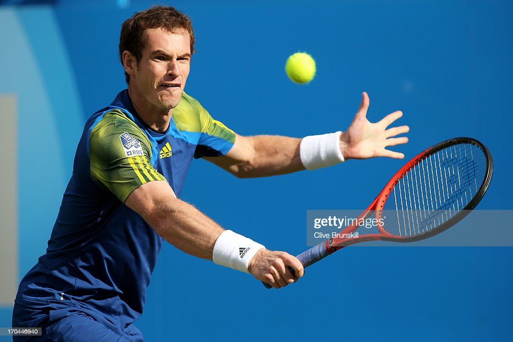 Andy Murray of Great Britain hits a backhand shot during the Men's Singles third round match against Marinko Matosevic of Australia on day four of the AEGON Championships at Queens Club on June 13, 2013 in London, England.