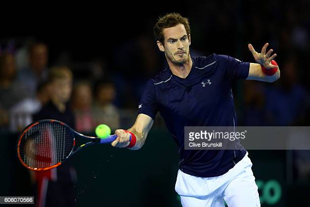 Andy Murray of Great Britain hits a forehand during his singles match against Juan Martin del Potro of Argentina during day one of the Davis Cup Semi...
