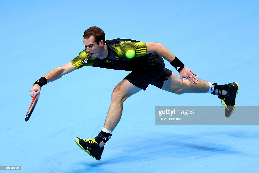<a gi-track='captionPersonalityLinkClicked' href=/galleries/search?phrase=Andy+Murray+-+Jogador+de+t%C3%A9nis&family=editorial&specificpeople=200668 ng-click='$event.stopPropagation()'>Andy Murray</a> of Great Britain hits a forehand during the men's singles match against Tomas Berdych of Czech Republic on day one of the ATP World Tour Finals at the O2 Arena on November 5, 2012 in London, England.