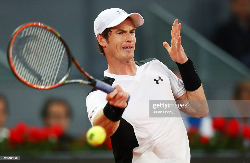 Andy Murray of Great Britain hits a forehand during the Men's Singles Quarter Final match against Tomas Berdych of the Czech Republic during day seven of the Mutua Madrid Open at La Caja Magica on May 6, 2016 in Madrid, Spain.