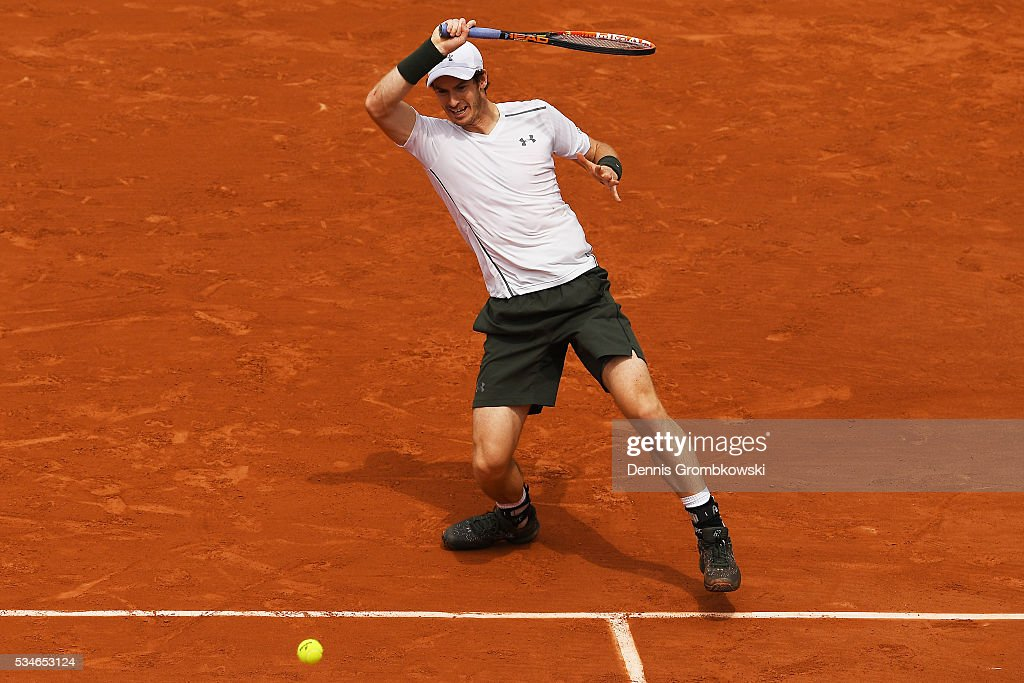 Andy Murray of Great Britain hits a forehand during the Men's Singles third round match against Ivo Karlovic of Croatia on day six of the 2016 French Open at Roland Garros on May 27, 2016 in Paris, France.
