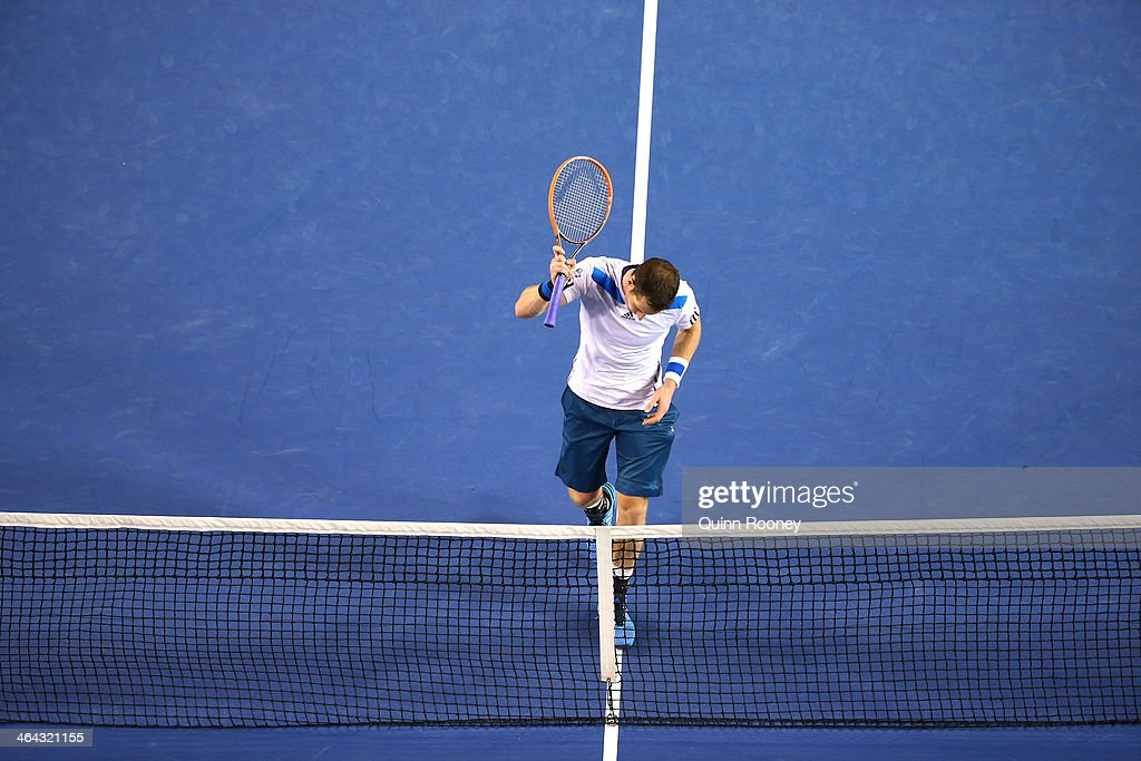 Andy Murray of Great Britain hits the net with his racquet in his quarterfinal match against Roger Federer of Switzerland during day 10 of the 2014 Australian Open at Melbourne Park on January 22, 2014 in Melbourne, Australia.
